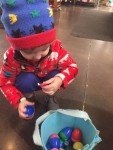 Young child opening candy from easter egg