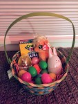 Easter basket filled with eggs and small gifts