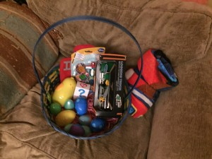 Easter basket filled with easter eggs, beanie boos, Driven truck, and more