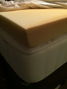 Four inch foam bed topper on top of mattress