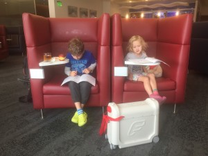 JetKids BedBox with two kids in airport lounger
