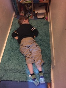 Child passed out on floor of closet