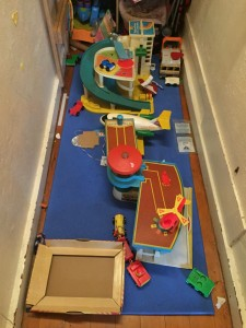Closet floor as play area with vintage Fisher Price Little People toys set up as city
