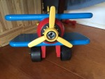 Battat Take Apart Airplane biplane in red, blue, and yellow parts with silver screws