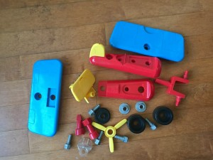 Battat Take Apart Airplane toy for toddlers in pieces on floor