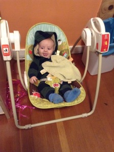 Infant in swing with Taggies little blanket