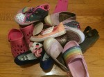 Pile of kid shoes on the floor