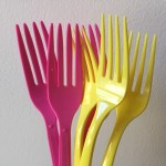 Pink and yellow plastic disposable forks
