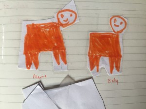 Child's drawing of mama and baby orange pigs