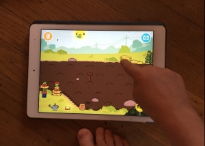 Child watering seeds in Toca Life Farm app on iPad device screenshot