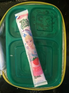 GoGurt Yoplait kid yogurt tube with Elsa packaging tucked into lunch box as cold pack