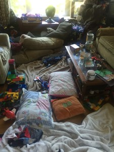 Messy living room kids pillows bedding and toys everywhere