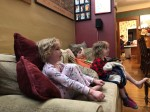 Kids sitting on sofa watching movie
