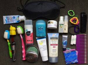 Travel packing bathroom stuff laid out neatly
