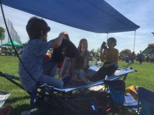 Kids playing on Mac Sports Portable Fold Up Hammock with shade in park on sunny day