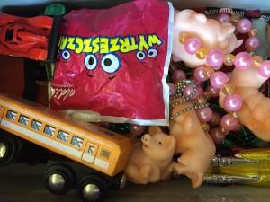 random assortment of toys in our purple reward shoe box