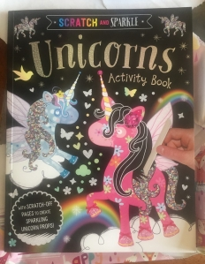 Scratch and Sparkle Unicorns Activity Book with pop out pieces and art
