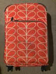 Orla Kiely roller board small rolling suitcase in orange and white flower stem print