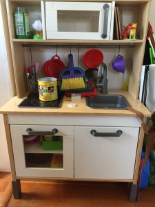 IKEA toy play kitchen with accessories hung