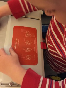 Child reading instructions printed on JetKids BedBox lid
