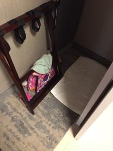 JetKids BedBox mattress on floor of hotel closet