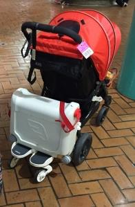 JetKids BedBox riding on Joovy stroller board glider board behind Snap stroller