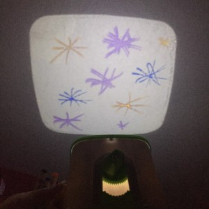 Crayola picture projector showing child's art on wall