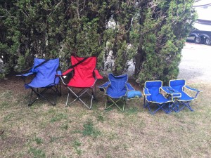 Empty camp folding chairs in a row