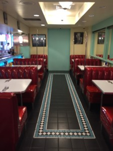 Diner in San Francisco shiny red booth and tile floor restaurant