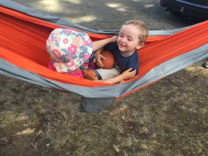 Eagles Nest Outfitters orange hammock with toddler and preschooler sitting inside