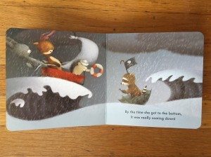 Red Wagon board book by Renata Liwska open page spread boat wagon on waves