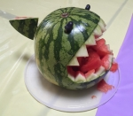 Watermelon shark from round watermelon at child's birthday pool party