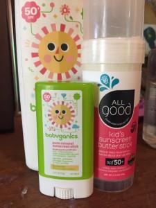 Babyganics SPF 50 sunscreen stick, lotion spray, and All Good Kids sunscreen butter stick