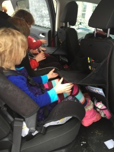 Kids with back seat organizer desk stocked with supplies