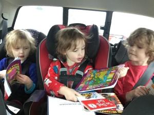 Kids in car seats explore road trip entertainment