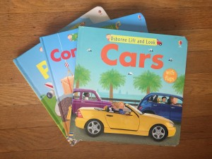 Usborne Lift and Look flap board books Cars Construction Sites and Planes in fanned stacked on hardwood floor