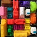 Rush Hour Junior STEM Kids logic game close up of brightly colored plastic vehicles