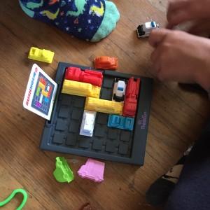Kids playing Rush Hour Junior logic game puzzle from ThinkFun