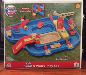 American Plastic Toys Sand and Water Play Set with four boats, wave maker, crane, and truck in box
