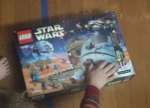 Star Wars Lego Advent Calendar box with child's hand on top