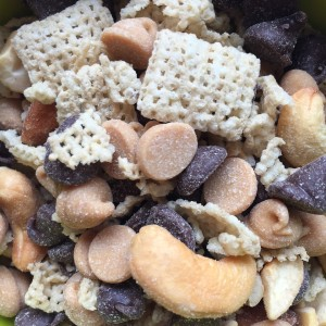 Snack mix close up with Rice Chex cashews almonds chocolate chips and peanut butter chips