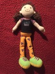 Manhattan Toys Groovy girls with orange legs and green shoes in Girls Rock! t shirt