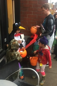 Kids trick or treating in business district