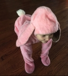 Child in pink bunny suit costume Halloween on hands and knees