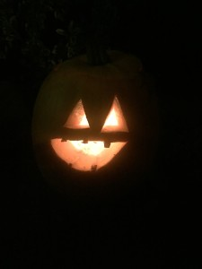 Light jack o lantern at night pumpkin carved by child