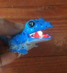 Blue lizard kids' animal flashlight with lightbulb in mouth lit up