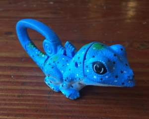 Blue lizard kids' animal flashlight with tail handle and light hidden inside mouth