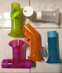 Boon Building Bath Pipes set of five water toy pipes with suction cups in pink, blue, orange, green, and white