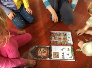 Four kids playing Logic Land The Enchanted Castle Deduction puzzle by Brainwright games