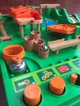 Run Yourself Ragged Screwball Scramble game green plastic board with orange accents marble challenge game